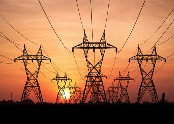 Electricity Pylons at sunset on background